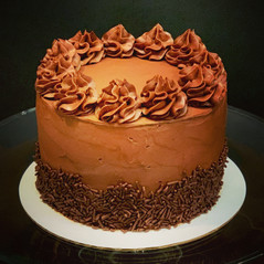 Chocolate cake with chocolate buttercream and chocolate sprinkle border