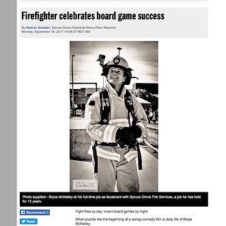 Dice Derbi creator Bryc McNalley celebrates boad game success.  Newspaper article.