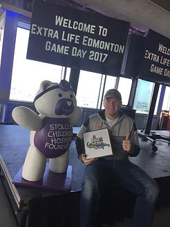 Dice Derbi donating to The Stollery Children's Hospital