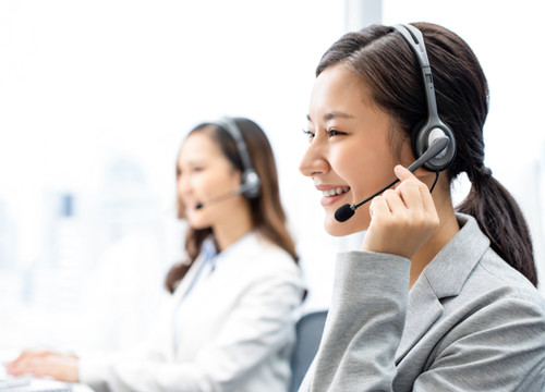 smiling-telemarketing-asian-woman-working-in-call-center-office.jpg