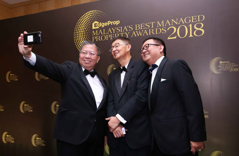 International Real Estate Federation (FIABCI) Malaysia vice president Mike Geh (left) taking selfie with Kim Realty Sdn Bhd Vincent Ng and MIEA president elect Lim Boon Ping.
