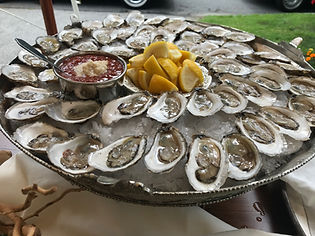 Oysters on the half shell, oyster shucking, hire a shucker