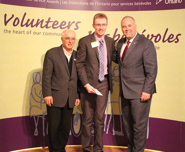 Brock Ormond receiving Ontario service award for volunteering