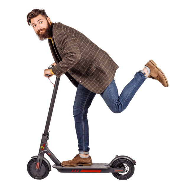 bearded man holding the electric scooter