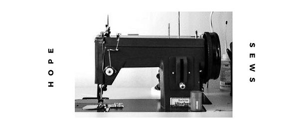 Black and white image of an old, vintage electric sewing machine flanked by HOPE SEWS text