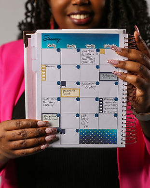 Woman is holding our business planner which has been decorated with a sticker set.