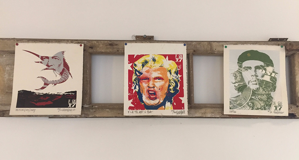 Three prints playing on themes of Ernest Hemingway, Donald Trump, and Che Guevara