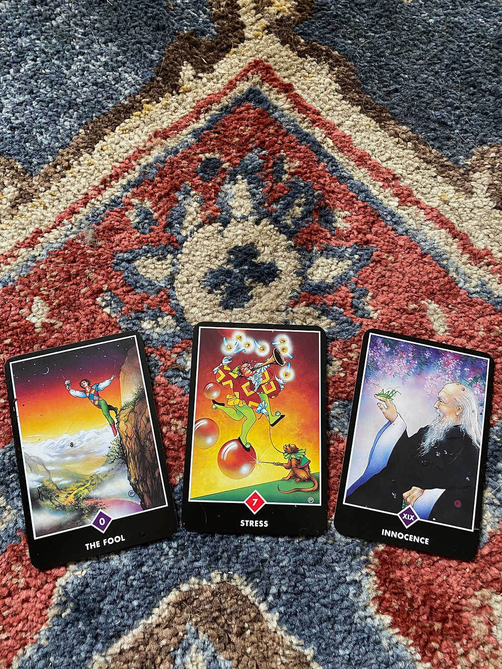 Taro cards depicting the Fool, Stress, and the Sage