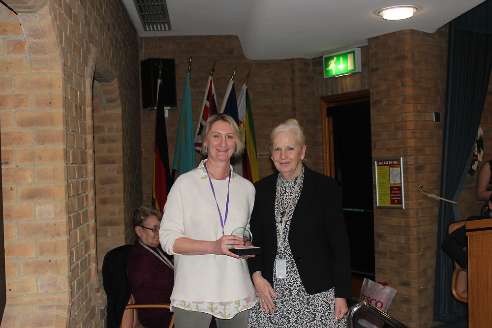 Rebecca Butterworth receiving her award