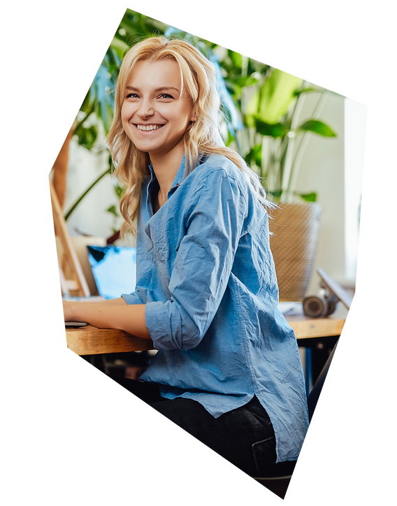 joyful-female-business-person-works-on-her-laptop--2J9QR89_2x.png