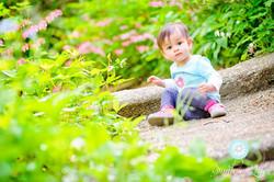 Toddler sitting in gardens