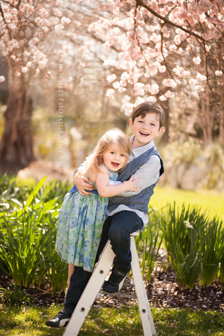 Siblings hugging in gardens