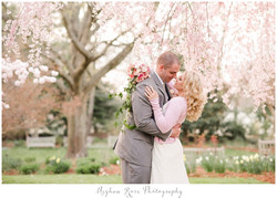 Couple in front of cherry blossom