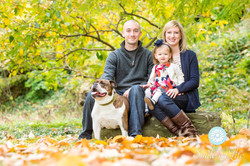 Family with dog in gardens