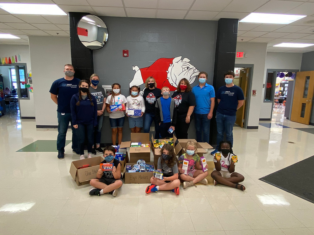 Surgere donated school supplies to AIM Academy.