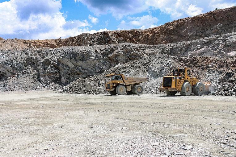 heavy equipment hauling rocks