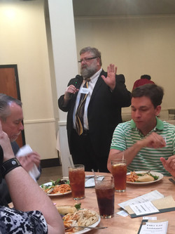 Sean speaking at Quarterly Luncheon