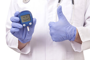 Doctor holding blood sugar meter and sho