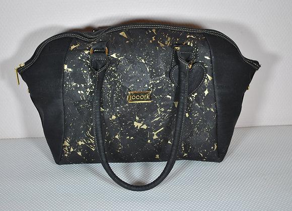 Zwarte handtas die zowel over de schouder als crossbody gedragen kan worden
