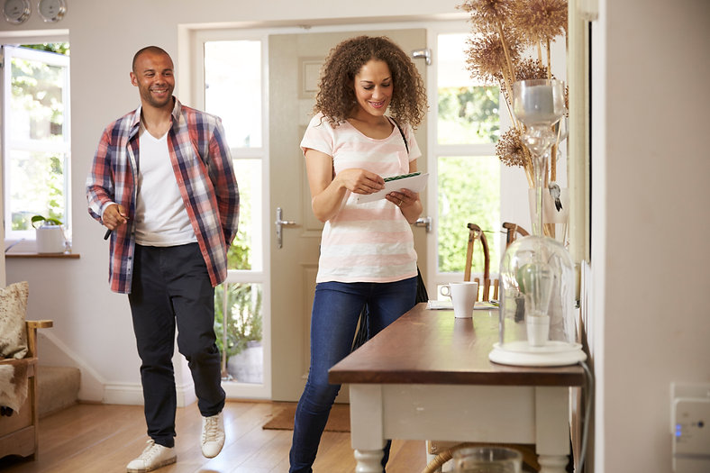 couple-in-hallway-returning-home-togethe