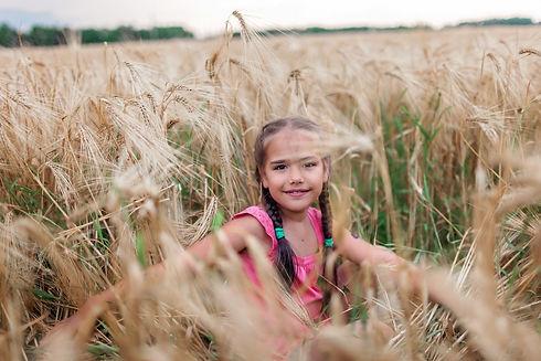 adorable-preschooler-girl-walking-happil