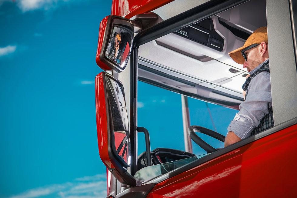truck-driver-in-the-cabin-2SECHYR.jpg