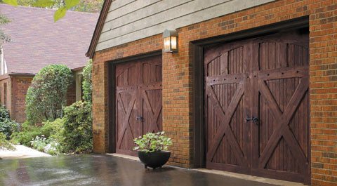 need to repair your garage doors - wood garage doors in the rain