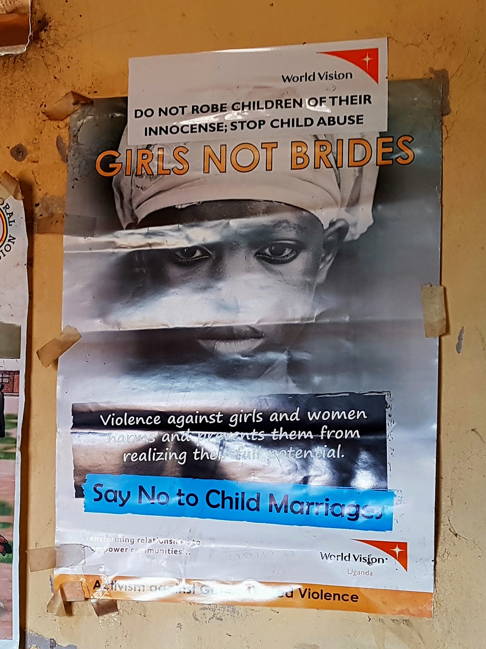 World Vision poster campaigning against child marriage. Office of a CLO in the Kole district.