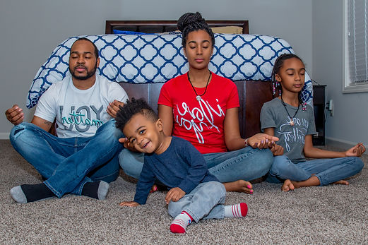 Beautiful African-American family practicing meditation. I love you. You matter. You are worthy. Woman. Man. Girl. Boy. Mother. Father. Daughter. Son. Bed. Wood. Socks. Self love. Self esteem. Self acceptance. Mental Health. Black Mental Health Matters.