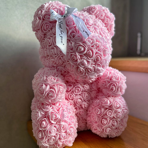 Světle růžový medvídek s mašlí