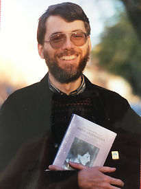Ed Hogan holding first edition of The Complete Poems of Anna Akhmataova, 1990
