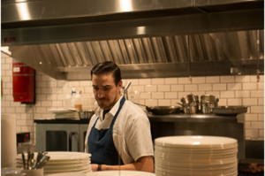 Man standing in the kitchen at a restaurant