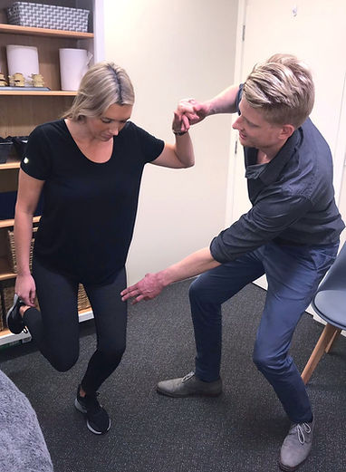 Lachlan Allen, Osteopath in Mount Eliza helping to correct single leg squat to improve hip stability which can be important in lower limb tendinopathy