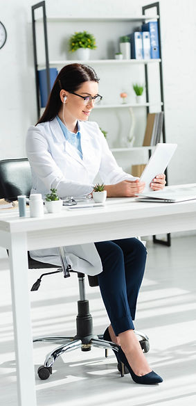 Female doctor holding a tablet