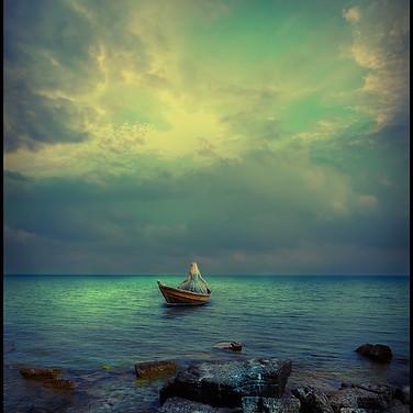 Kvinna i båt.