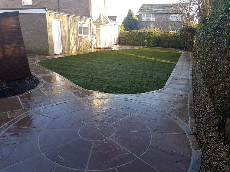 Stone Paved Garden with Grass in Centre
