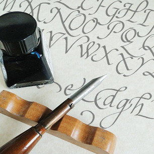 Fountain Pen and Ink-Pot on Caligraphy alphabet
