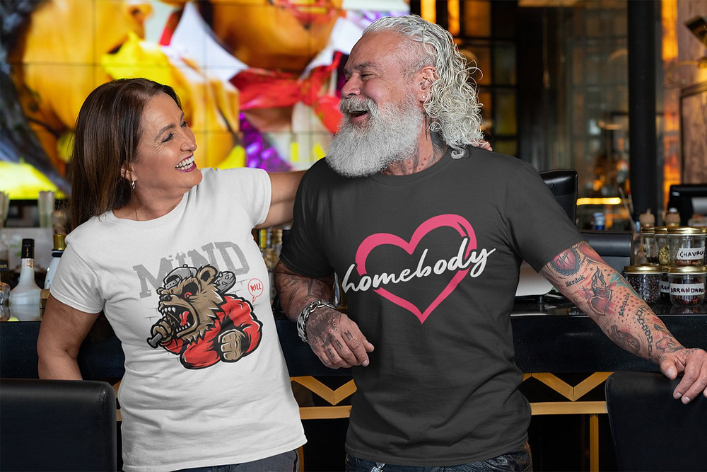 Senior couple dressed in custom t-shirts having a conversation at the bar.