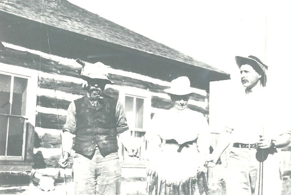 Unidentified Persons in front of cabin