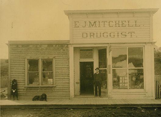 E.J. Mitchell, Druggist