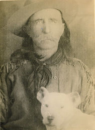 "JOHN GEORGE ""KOOTENAI"" BROWN with JACK RUSSELL DOG"