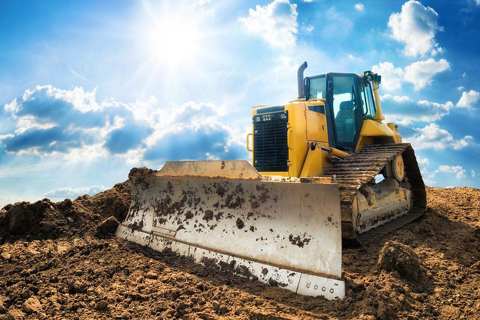 Yellow excavator on new construction sit