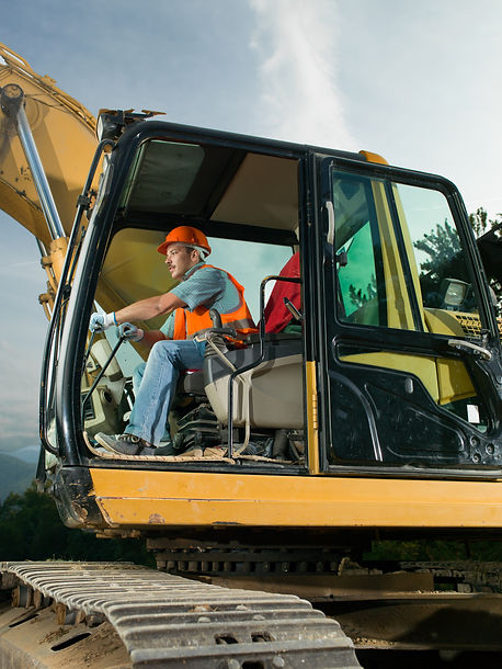 male worker operating excavator on const