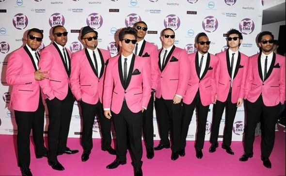 Bruno and Group In Pink Suits