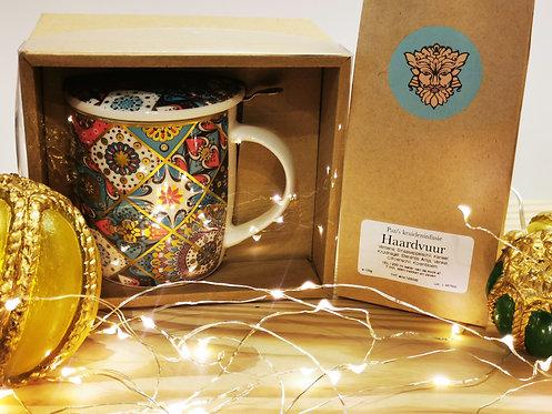 Theetas mét zeefje en thee