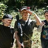 Boys with laser tag guns saluting