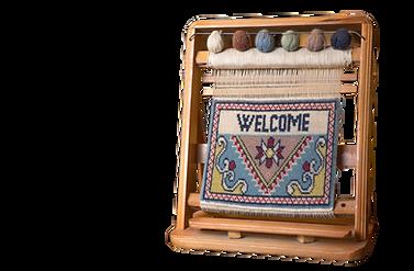 Mini loom with handmade rug sample
