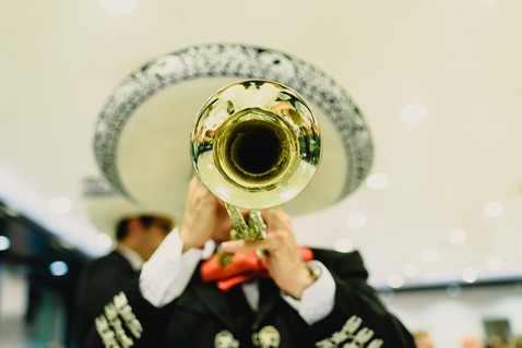 Mexican musician with his trumpet and gu
