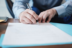 closeup-of-manager-signing-contract-in-b