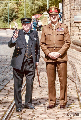 Winston Churchill and Feild Marshal Lord Alanbrooke acknowledge and pose for the press